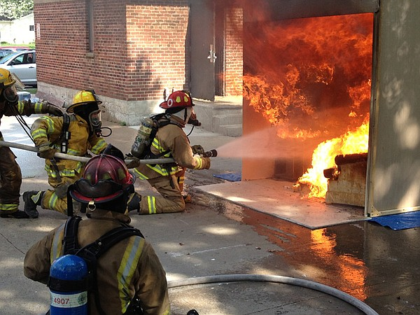 David Pogue (upper middle left) and firemen extinguish fi...