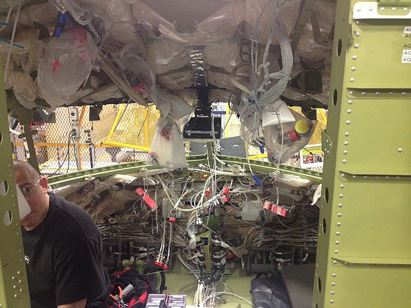 Interior of plane being wired.