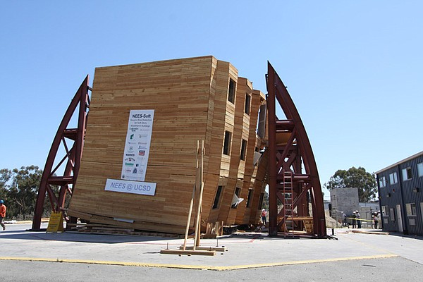 Collapsed wood frame soft story test building on the UCSD NEES shake table.