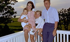 Taken August 4, 1962, the Kennedys in Hyannis Port, (from left) John Jr., Jackie, Caroline and John.
