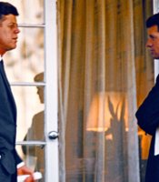 President Kennedy confers with Attorney General Kennedy, White House, outside of Oval Office.