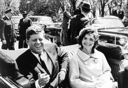 President John F. Kennedy and Jacqueline Kennedy traveling in car, May 1961.