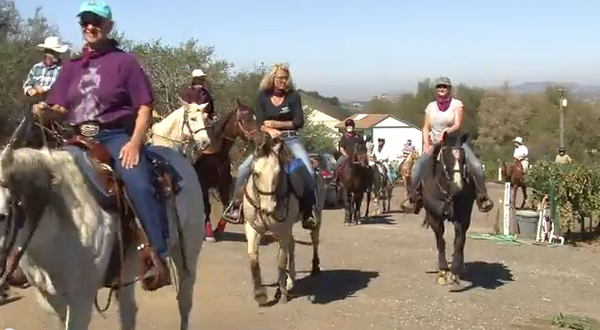 Horseback riders with Ramona Trails Association take a wine tasting tour in R...