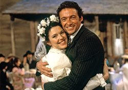 Josefina Gabrielle as Laurey, and Hugh Jackman as Curly in