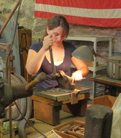 Chloe Darke works at Old Newbury Crafters in Amesbury, Massachusetts.