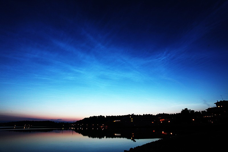 Noctilucent clouds that appeared at the altitude of 80km above the ground.