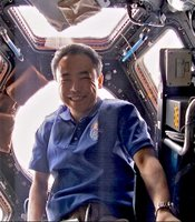 Dr. Satoshi Furukawa in the Cupola, and Earth-facing observatory module of the ISS.