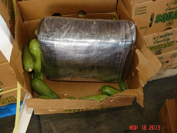 While inspecting a large tractor-trailer, Border Patrol officers detected anomalies within cardboard boxes of squash using the port's imaging system and discovered 369 pounds of marijuana hidden among the produce.