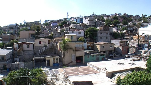 This neighborhood, Colonia Solidaridad Gabriel Rodriguez, started out as a handful of squatters' shacks, in 1991. Most families have made significant improvements to their homes.