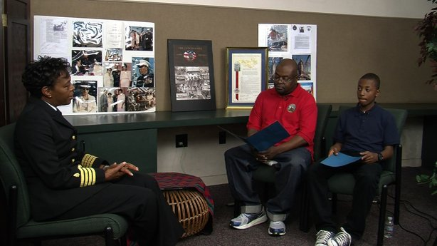 Corwin Harris, and his son Corwin, Jr. interview a current Navy nurse as part of Project Ujima's Montford Point Marines project at the Malcolm X Public Library, Nov. 15, 2013.