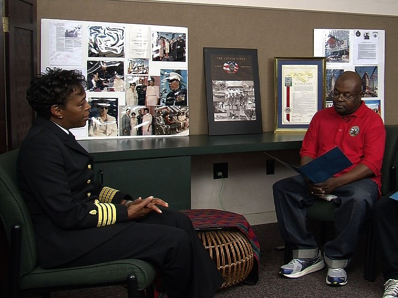 Corwin Harris, and his son Corwin, Jr. interview a current Navy nurse as part...