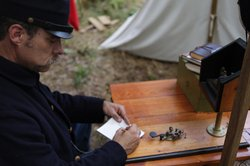 Reenactment of soldier using telegraph in the field in
