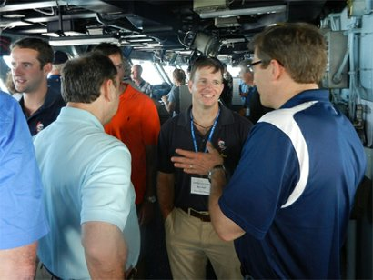 "Cmdr. Sam Tanner speaks with former ""Blue Blasters"" on the bridge of the USS ..."