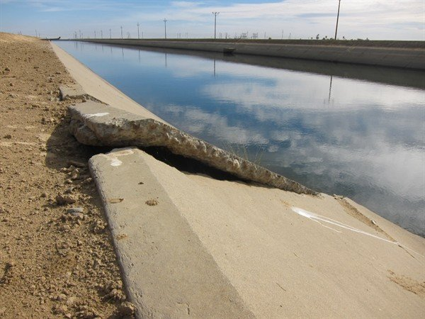 Cracks and buckle in concrete lining of Delta Mendota Canal.