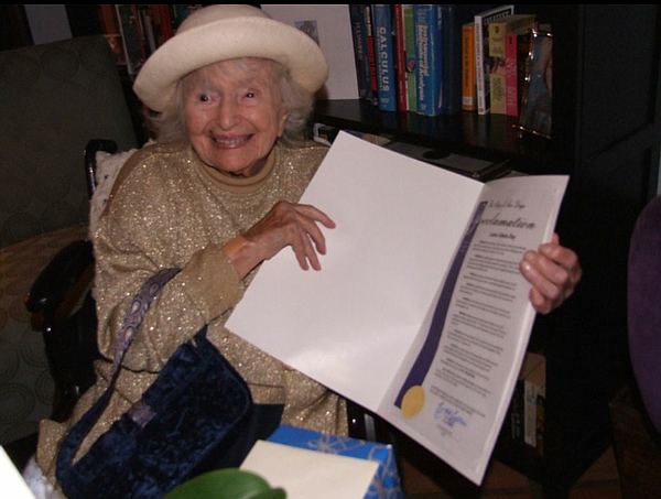 108-year-old Laura Simon holds up her proclamation, declaring it her special ...