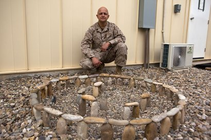 Gunnery Sgt. Gregory Miller with his model of Stonehenge at Camp Bastion, Nov...