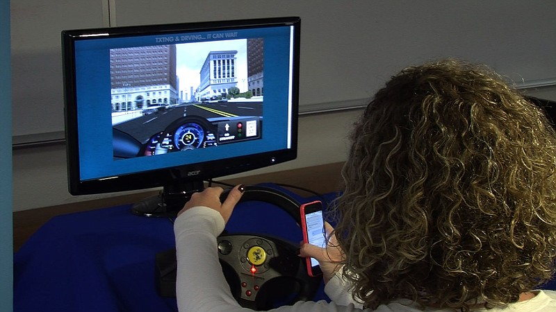 This driving simulation is part of the one-hour training classes offered by U...