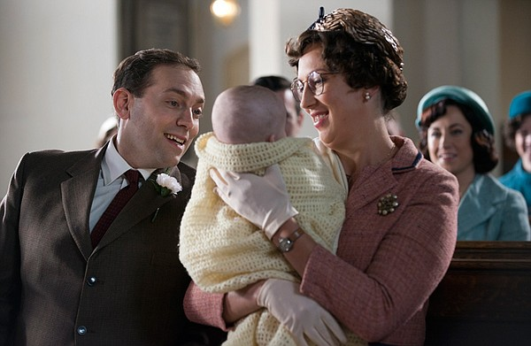 Ben Caplan as PC Noakes and Miranda Hart as Chummy in church with baby Freddie.