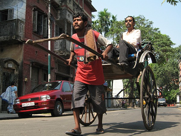 Manoj Singh, a rickshaw driver living in the slums of Kol...