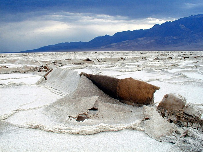 Uplift on the salt flats, Badwater Basin, Death Valley. As salt crystals grow...