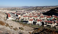 Some 14,000 homes make up Villa del Prado, a suburban development on the outskirts of Tijuana. One in four homes sits abandoned.