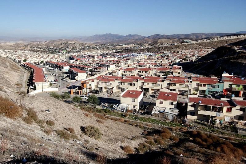 Some 14,000 homes make up Villa del Prado, a suburban development on the outs...