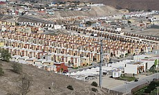 Planned housing developments continue to be built on the outskirts of Tijuana...