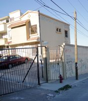 Gated streets in neighborhoods like Villa del Prado were marketed for their exclusivity and safety. Here they haven't escaped vandalism.
