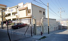 Gated streets in neighborhoods like Villa del Prado were marketed for their e...