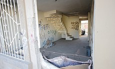 "Squatters and delinquents sometimes take over abandoned homes. See more photos of Tijuana's suburbs <a href=""http://www.kpbs.org/photos/galleries/2013/dec/19/tijuanas-distant-suburbs-decline/"">here</a>."
