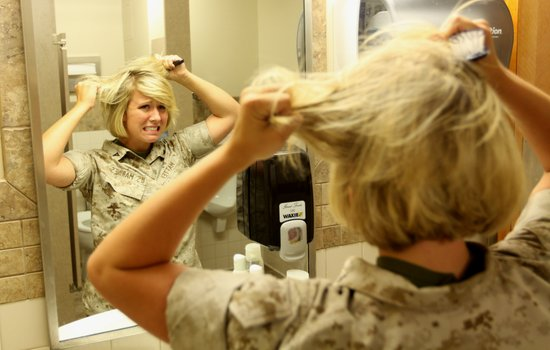 Camp Pendleton Marine does her hair in the morning, 2010.