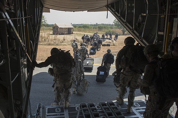 U.S. soldiers and East Africa Response Force soldiers depart a U.S. Air Force...
