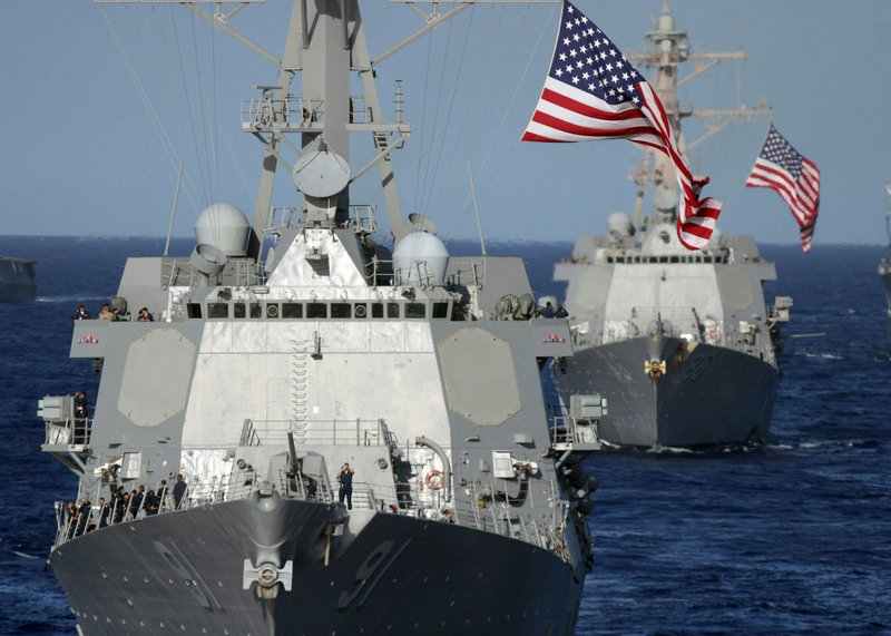 The guided-missile destroyers USS Pinckney (DDG 91) and USS Shoup sail in for...