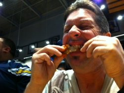 Brian Ochaba bites into the blazin' wings challenge at Buffalo Wild Wings, J...