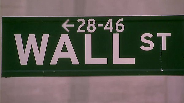 Wall Street sign. FRONTLINE goes inside the dramatic, unprecedented hunt that...