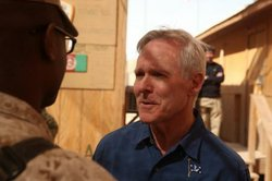 Navy Secretary Ray Mabus speaks to a Marine in Afghanistan, 2012.