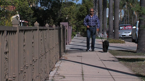 South Park resident Noble Robinson walks his dog Peter every day on what he d...