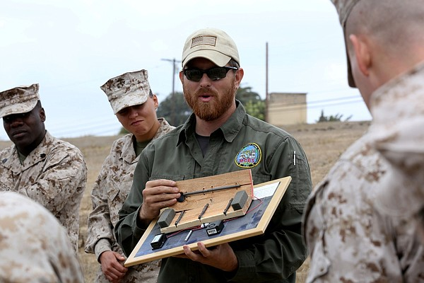 Jonathon Taylor, counter improvised explosive device instructor, shows Marine...