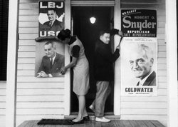 The Bonhomme Township Democratic Organization and the Robert Snyder election campaign have each rented half of a building in St. Louis. Members of each organization tack up posters for opposing candidates, particularly for Johnson and Goldwater, September 26, 1964.