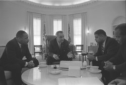President Lyndon B. Johnson meets with Civil Rights leaders: (L-R) Martin Luther King, Jr., President Lyndon B. Johnson, Whitney Young, James Farmer, January 18, 1964.