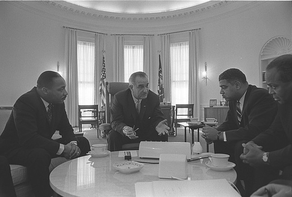 President Lyndon B. Johnson meets with Civil Rights leaders: (L-R) Martin Lut...