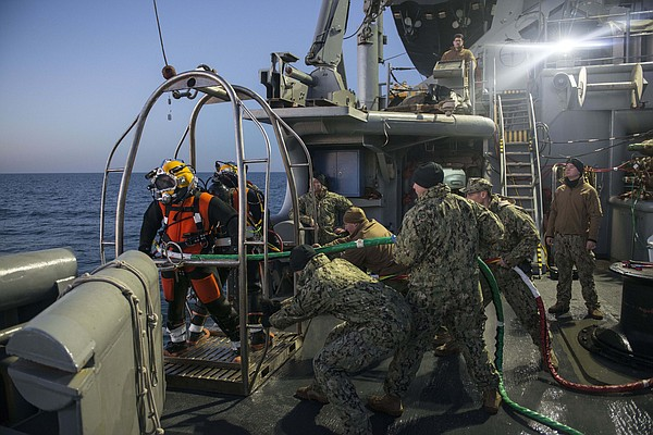 Navy divers assigned to Mobile Diving and Salvage Unit (MDSU) 2, Company 2-2,...