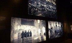 A panel at the LACMA exhibit featuring images f...