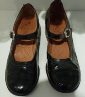 "A pair of the shoes worn by the creepy twins in ""The Shining."""