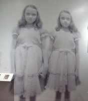 A giant blown up image of the twins watched over visitors to the exhibit.