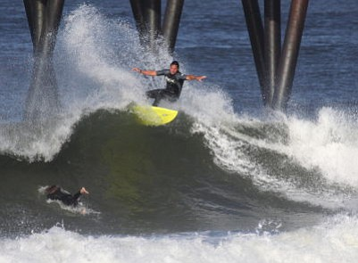 Serge Dedina surfing south of the Imperial Beach Pier in ...