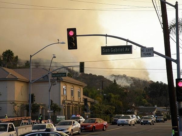 Smoke from the Colby Fire encroaches on a Glendora neighborhood in this undat...