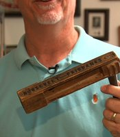 Clairemont history teacher Jim Fletcher demonstrates how much noise an oak noisemaker from Teddy Roosevelt's 1904 campaign can still make.