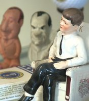 A salt and pepper shaker set that depicts John F. Kennedy in one of his iconic rocking chairs. Kennedy suffered from chronic back pain, which the chairs eased.