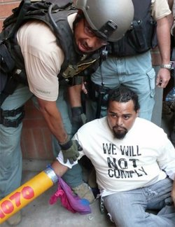 Carlos Garcia arrested as he protests the implementation of SB 1070.